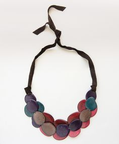 A statement necklace in every sense of the word. Layers of hand cut, dyed, and polished tagua seed are nestled together to form a striking go-to piece. Available in Plum and Teal. - See more at: http://www.noondaycollection.com/necklaces/scattered-steps-necklace-plum#sthash.v5OKdMvt.dpuf