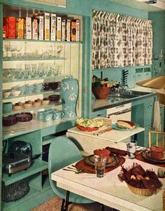 Love this blue kitchen and the open shelving. April 1957 House Beautiful.