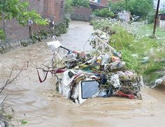 Trash covers a truck submerged in flood waters from heavy monsoon rains in Dehradun in the Indian state of Uttrakhand on June 17, 2013. Posted by floodlist.com #floods #uttarakhand