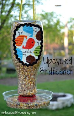 Upcycled Birdfeeder.  ----  You could also use old creamer containers - painted, etc or whatever else you can re-cycle!! Great Idea!! So Cute!!