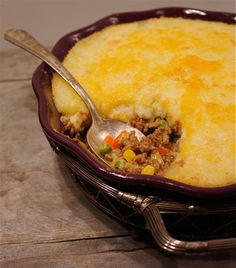 Irish cottage pie: russet potatoes, ground beef, yellow onion, garlic, extra virgin olive oil, salt, pepper, molasses, tomato paste, apple cider vinegar, carrot, frozen corn, frozen peas, butter, heavy cream, and shredded cheddar cheese