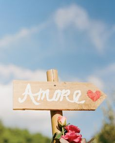 A hand-painted sign points the way to the ceremony