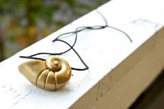 Shell Necklace, inspired by Ursula's Necklace from The Little Mermaid. I could totally make this, and I will!