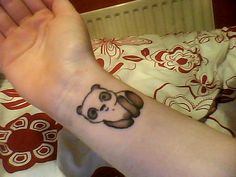 When i have a child i will get a panda tattoo and write their name under it <3
