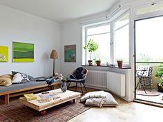#livingroom #white #walls #wooden #table #wheels