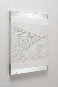 DIY idea: tie twine or yarn around a canvas THEN paint it.  Hmmmm....