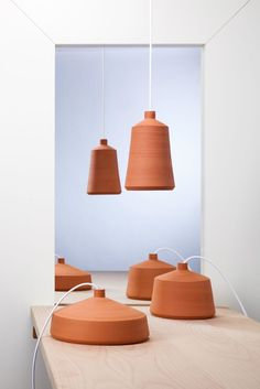 Each of Pott's Flame Pendant Lamp is unique and has been hand crafted with care and dedication, mixing traditional pottery techniques and natural materials to contemporary lighting designs.