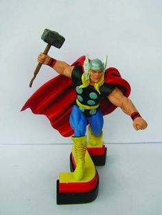 """Avengers Resin Figures - Thor on Letter Base """"S"""" by Marvel. $19.99. One of 8 pieces that can be assembled to spell out Avengers. Colorful costumed characters great gifts for students and professionals alike. Thor with his Mjolnir ready to strike stands posed atop letter S base. Use as paperweight or display on shelf. Hand detailed figural and dynamic pose. From the Manufacturer                They are Earth's mightiest heroes, formed to battle foes no single hero coul..."""