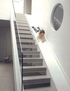 WHO WOULDNT WANT A STAIRCASE WITH A SLIDE?!