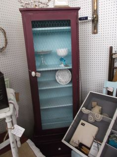 $95 - Cute farmhouse cabinet with chicken wire in door - two tone paint finish.  ***** In Booth E8 at Main Street Antique Mall 7260 E Main St (east of Power RD on MAIN STREET) Mesa Az 85207 **** Open 7 days a week 10:00AM-5:30PM **** Call for more information 480 924 1122 **** We Accept cash, debit, VISA, MasterCard or Discover.