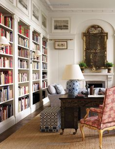 Sconces on bookcases, lamp, art above bookcases