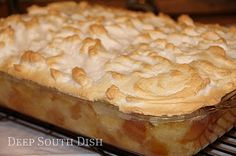 """Deep South Dish: Old Fashioned New Orleans Creole Bread Pudding with Meringue.."""" A signature dessert at Commander's Palace restaurant in New Orleans this rich, meringue topped bread pudding souffle, drizzled with whiskey sauce"""""""