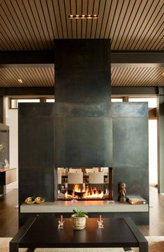 Patina'd steel as an idea for the fireplace and TV surround