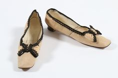 A pair of Gaudinot pale apricot cotton summer shoes, edged in black lace, French, circa 1865.
