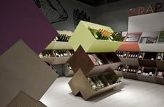 Grapy store in Roosendal Bookshop. Store design by Storeage. Capitalising on the inseparable pairing of food and wine, the Grapy Store is housed in the same space as the Het Verborgen Rijk bookstore, right next to its cooking section.
