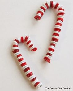 Button crafts are super popular. So why not use buttons to make homemade Christmas ornaments? These Adorable Button Candy Cane Ornaments will really make the family tree stand out.   AllFreeKidsCrafts.com