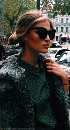 Loving those sunglasses- are those the new 2014 Chanel glasses?