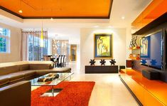 modern orange living room with brown sofas and orange carpet 20 Ways to Use Color Psychology in Your Home