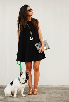 Black swing dress, silver pendant, gold sandals, python clutch, (and french bulldog).
