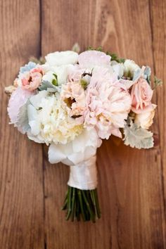 LOVE this bouquet! More peaches and yellows, less pink.  Leaves and berries are awesome and so are the big, soft flowers.