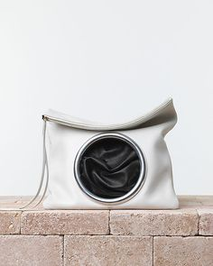 CÉLINE | Summer 2014 Leather goods and Handbags collection. Soft pouch eyelet handbag. In Nappa lambskin chalk/black