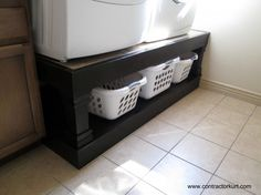 raised washer & dryer platform with room for laundry baskets underneath