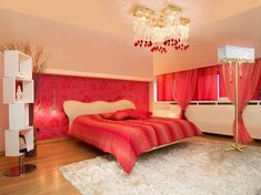 Romantic red room...How fun! Love the accent wall and the flowy curtains