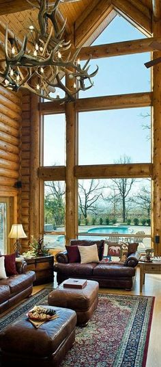 Handcrafted log home with high ceiling and great expanse of window