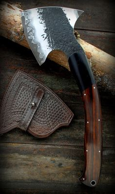 hand forged tomahawk/axe with Damascus watermark on the blade
