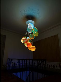 Glowing Earth Chandelier Uses Recycled Globes by Benoit Vieubled