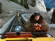 Buster Keaton knitting on the railway
