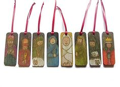 handpainted wooden christmas decorations.  Nativity characters each with a christmas carol quote on the back.