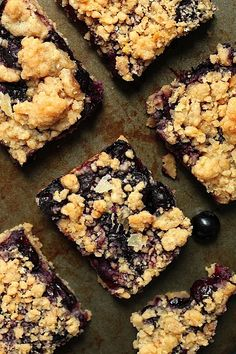 Blueberry Crumb Bars - An easy recipe for light and luscious blueberry crumb bars! These berry packed little squares have a simple shortbread crust, a juicy fresh blueberry filling, and an addictive crumb topping!