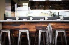 breakfast bar. love the stools. love the rustic wood planked look on the bottom.