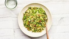 You need day-old rice to make this vibrant, springy pilaf recipe, but it's worth planning ahead. The precooked rice gets super crisp before it's tossed with soft feta, crunchy pistachios and snap peas, and jammy golden raisins. It's a true study in textures.
