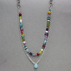 Confetti Necklace: This whimsical necklace is sure to be your go-to piece all summer long!  Silver plated chain supports a rich chalcedony teardrop and a fun array of gemstones, Swarovski crystals and glass beads.  Length: approx. 23 inches.  Exclusively from Bead World Inc.