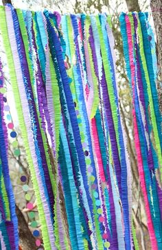 A beautiful backdrop of sewn streamers and paper garlands... lovely! #backdrop #streamers #garland