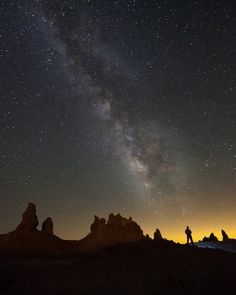 """""""Stargazing"""" by Jeffrey Sullivan. Winner of the """"People & Space"""" category of the Astronomy Photographer of the Year 2011 competition. The silhouetted photographer almost seems to be part of the rocky landscape. ©Mona Evans, """"Astronomy Photographer of the Year 2011"""" http://www.bellaonline.com/articles/art50195.asp"""