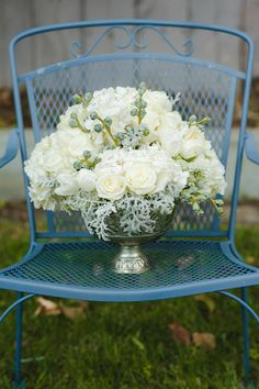 Hydrangeas and roses are the stars of this rustic centerpiece {Bay Blossoms}