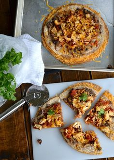 """This food blogger says this may be """"the tastiest nosh you've ever noshed. I think I'll never make another quesadilla again because this was just like, laughably-not-even-comparably waaaay better. Mexican Black Bean Pizza - made with tortillas for crust."""