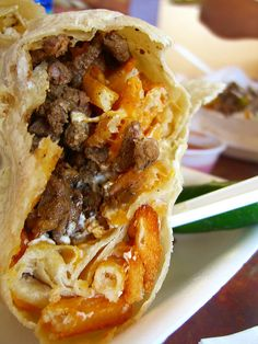 carne asada + cheese + sour cream + french fries = lolita's california burrito. So bad for you, but it dances on the tastebuds. :) sounds like it would be an amazing pregnancy meal!