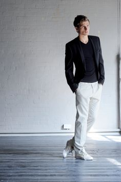 sleek black vest, dark blue v-neck tee, white chino pants, beige converse / men fashion. White pants, been in the netherlands long enough to justify wearing them? :-)