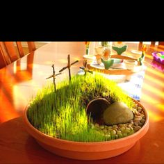 Make your own Easter garden! Use a partially buried flower pot for the tomb, rocks, grass seed. Would totally do this if I had spare time!