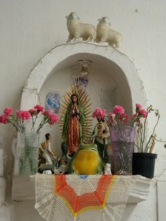 altar in valle De Bravo Mexico, love those little lambs on the top