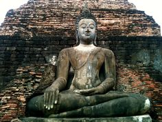"""Our travels lead us to some interesting places...  This monument is located in Sukhothai (สุโขทัย), a small city in lower Northern Thailand, most famous for the ruins of the ancient. The name translates as """"the dawn of happiness""""."""
