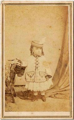 This photo has gone a few rounds in the ring with the hands of time, but still, 150 years on, the darling spirit of the little girl it immortalized lives on through its sepia tones. ##Victorian #19th_century #1800s #photograph #antique #vintage #girl #child