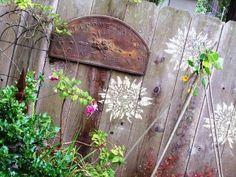 Stencils on fence diy fenc, sidewalk chalk, fences, garden design ideas, backyard, modern garden, stencil, flower, fenc decor