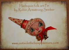 Harlequin pin~resin, pain and silk ribbon, with a brass bunny charm