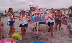The beach badge inspectors take a break to play a Bubble Beach .....