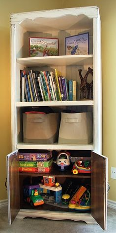"""An old entertainment center into a bookshelf and toy """"chest"""" for a children's room."""